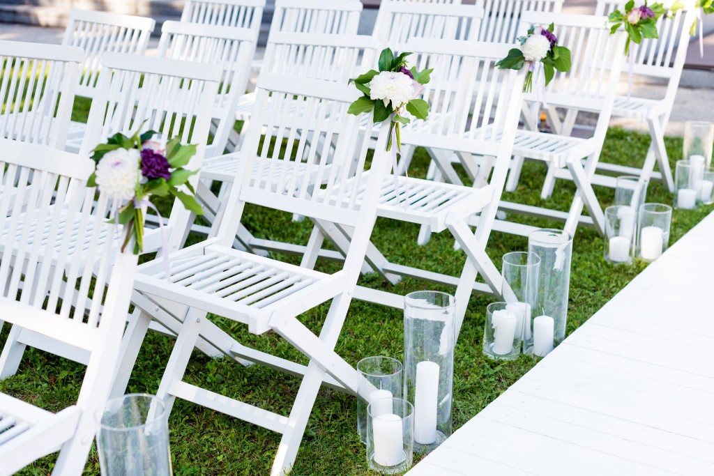 Wooden or decorative chairs add a touch of elegance as opposed to plastic ones.