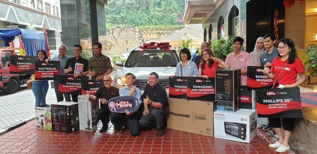 Winners from StarProperty's home buyer contest in 2019 pose with their prizes alongside Vogiatzakis and Towle.
