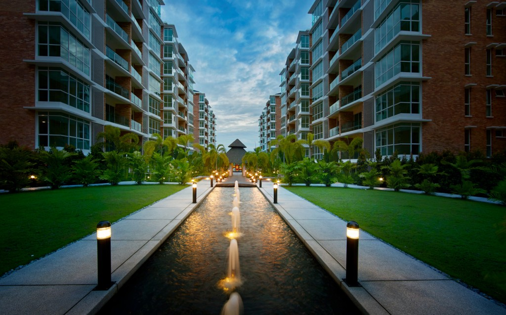 Strategically planted trees and artful lighting provide a quaint atmosphere amidst a bustling city life.
