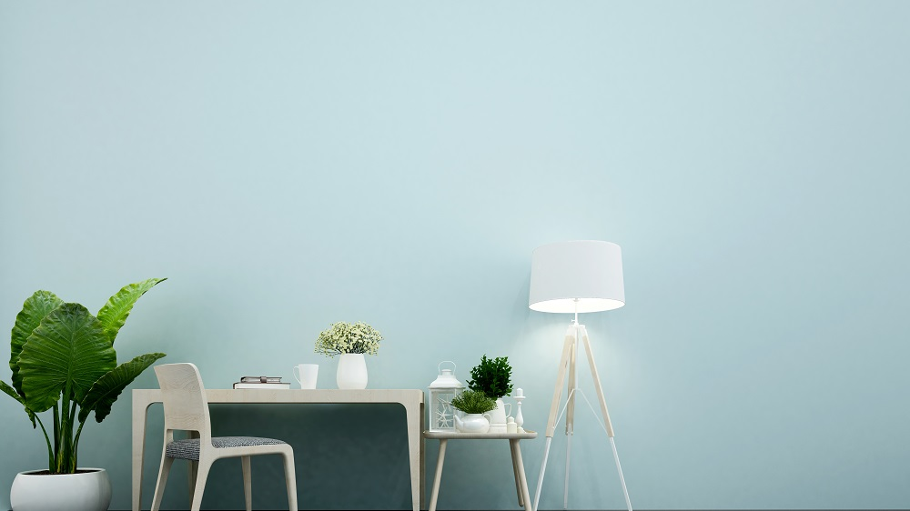 workplace in office or dining room in home and light blue wall d