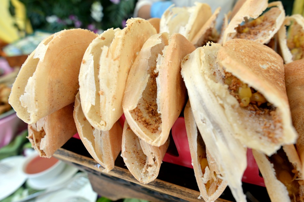 Apam balik is a sweet Asian pancake typically found at roadside stalls, with either a crispy or fluffy variation.