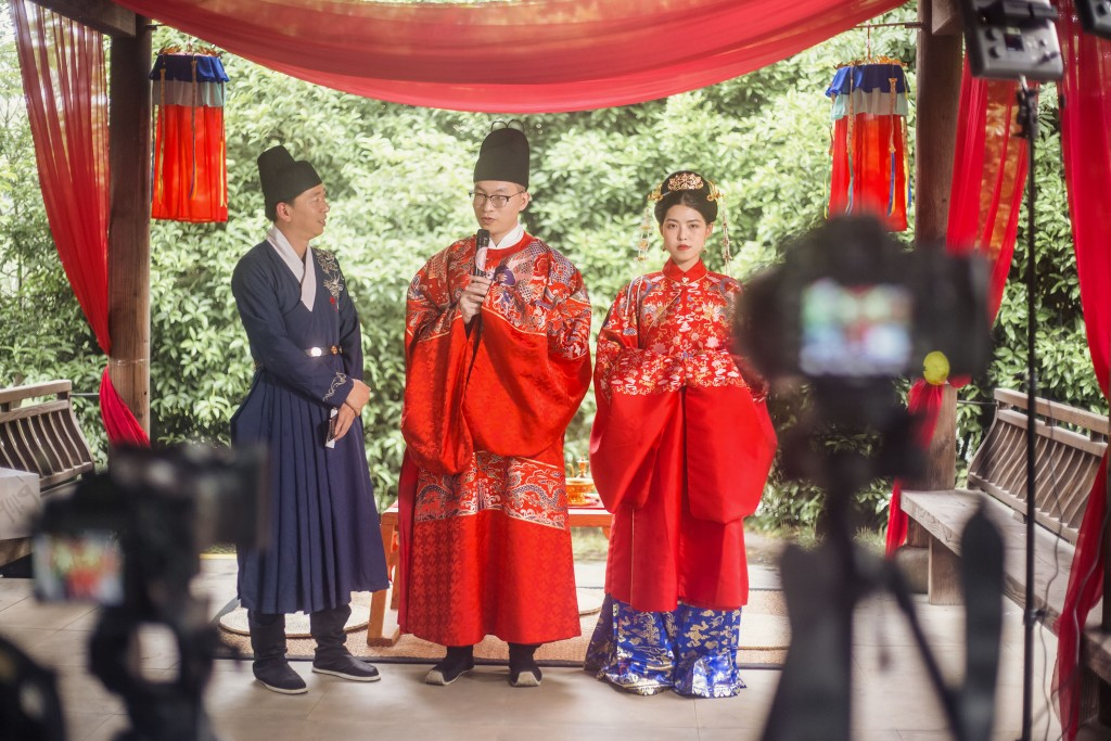 A traditional marriage ceremony in China being witnessed by guests online.