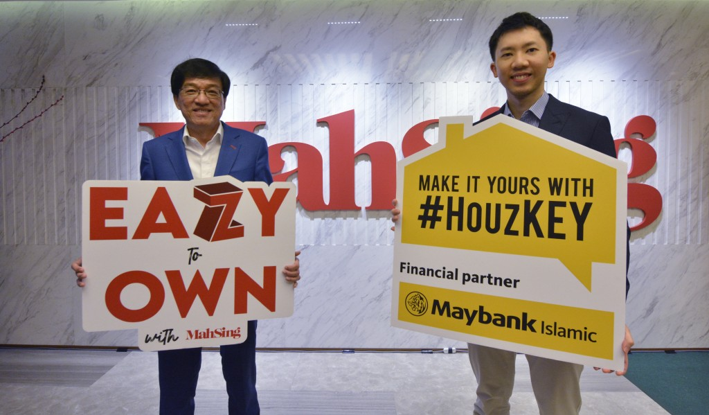 Mah Sing CEO Datuk Ho Hon Sang and group strategy and operations director Lionel Leong holding placards depicting the latest promotions.