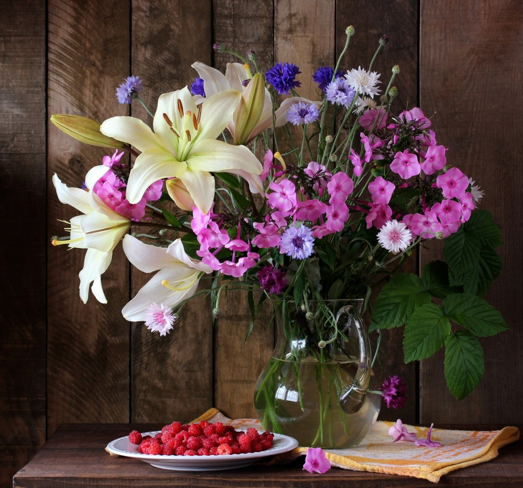 summer bouquet of lilies, phlox and cornflowers in a jug