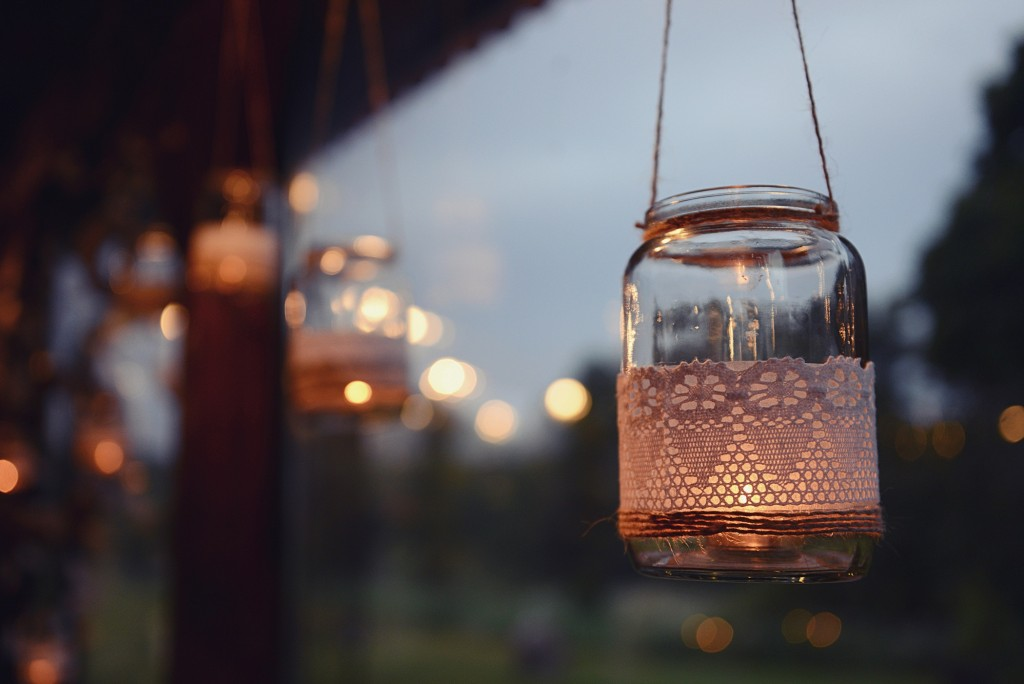 Mason jar candle hanging for wedding decor. Evening light. window