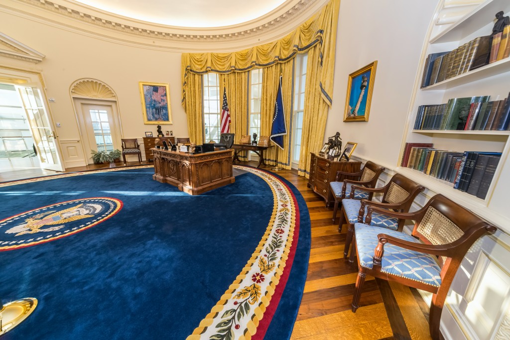 White enamel wainscot tracing back centuries as can be observed on the walls of this replica of White House Oval Office, Washington DC.