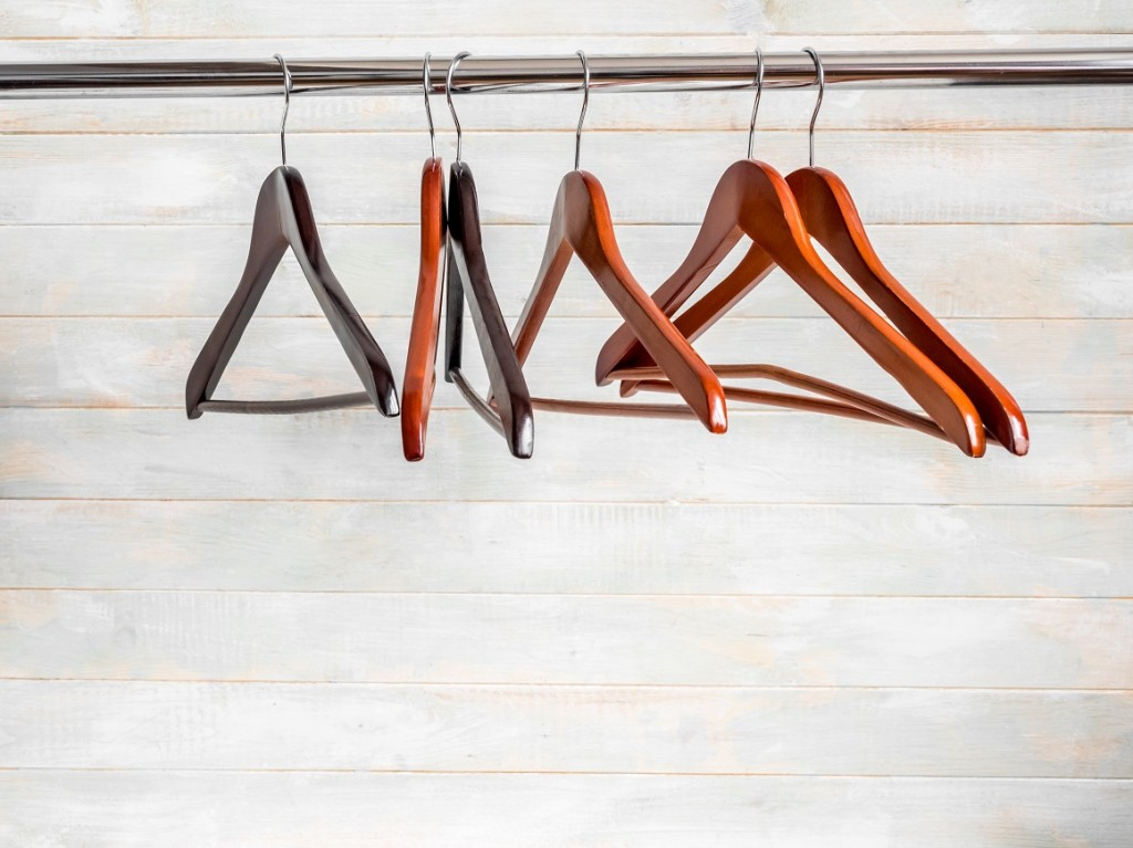 Brown wooden hangers on the rack