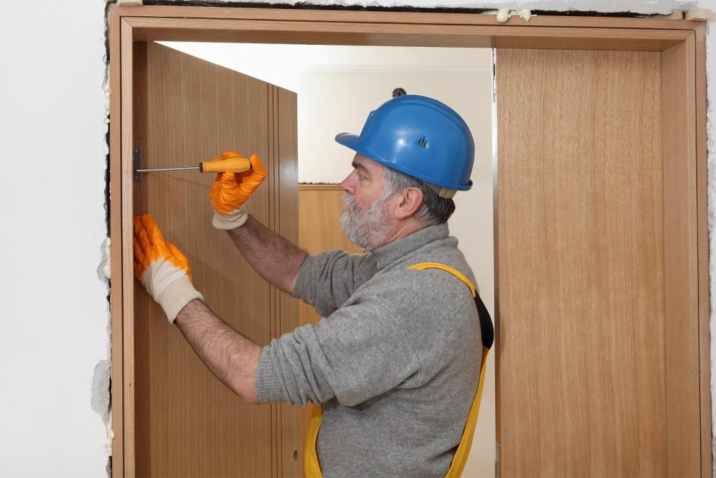 Worker install new door