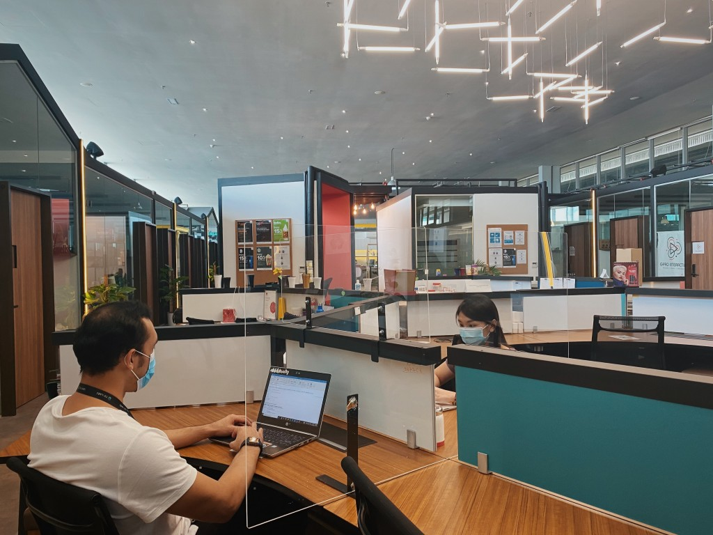 Co-Labs Coworking offices add transparent plastic shields to provide better protection to their clients.