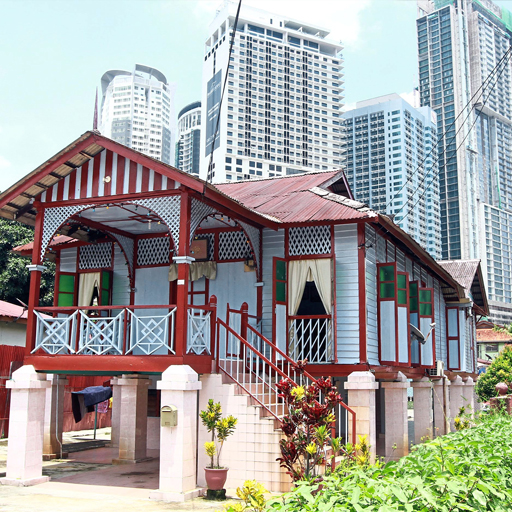 Traditional houses  depicting the  Malay architecture  identity stand  out against the  backdrop of the KL  city centre, giving  a sharp contrast  between the old  and the new.