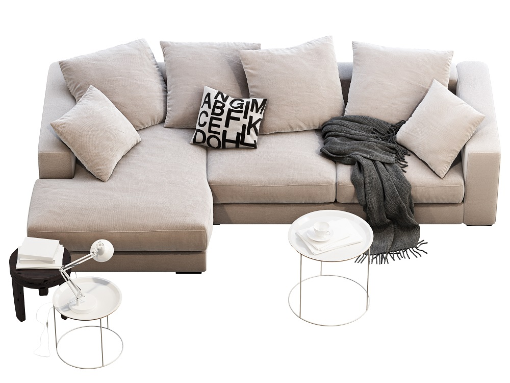 Small middle pillow with graphics unites the white sofa, black throw blankets and the other furniture.