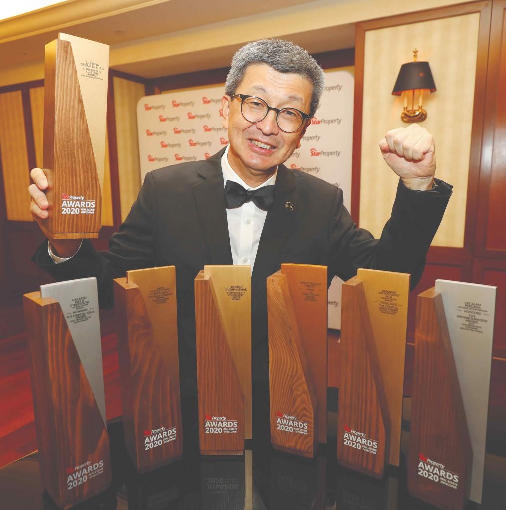 LBS group managing director Tan Sri Lim Hock San celebrates his big trophy haul.