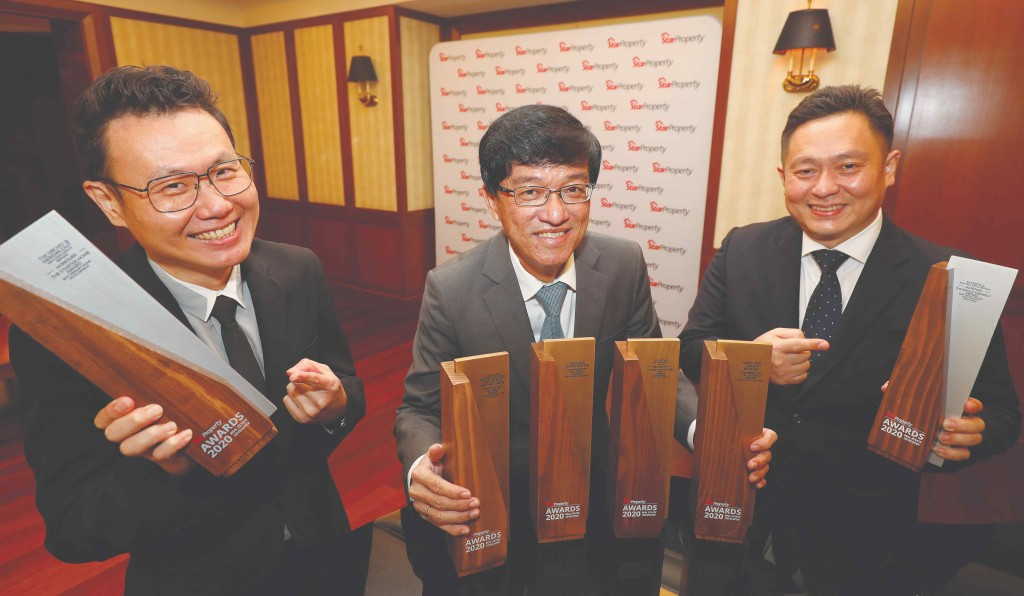 It's all smiles for Mah Sing CEO Datuk Ho Hon Sang (centre), chief operating officer Yeoh Chee Beng (right) and sales and marketing general manager Chris Chen Weng Hong as they show the number of trophies the group has won.