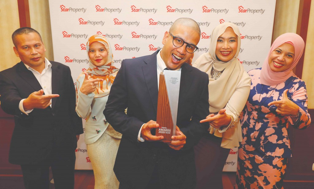 The Worldwide Holdings team celebrates after winning the award. From left are acting property general manager Azmi Ali, assistant sales manager Shiela Tajudin, sales and marketing senior manager Amirul Azhar, project manager Sharifah Farida Anum and assistant marketing manager Yusnita Yaacob.