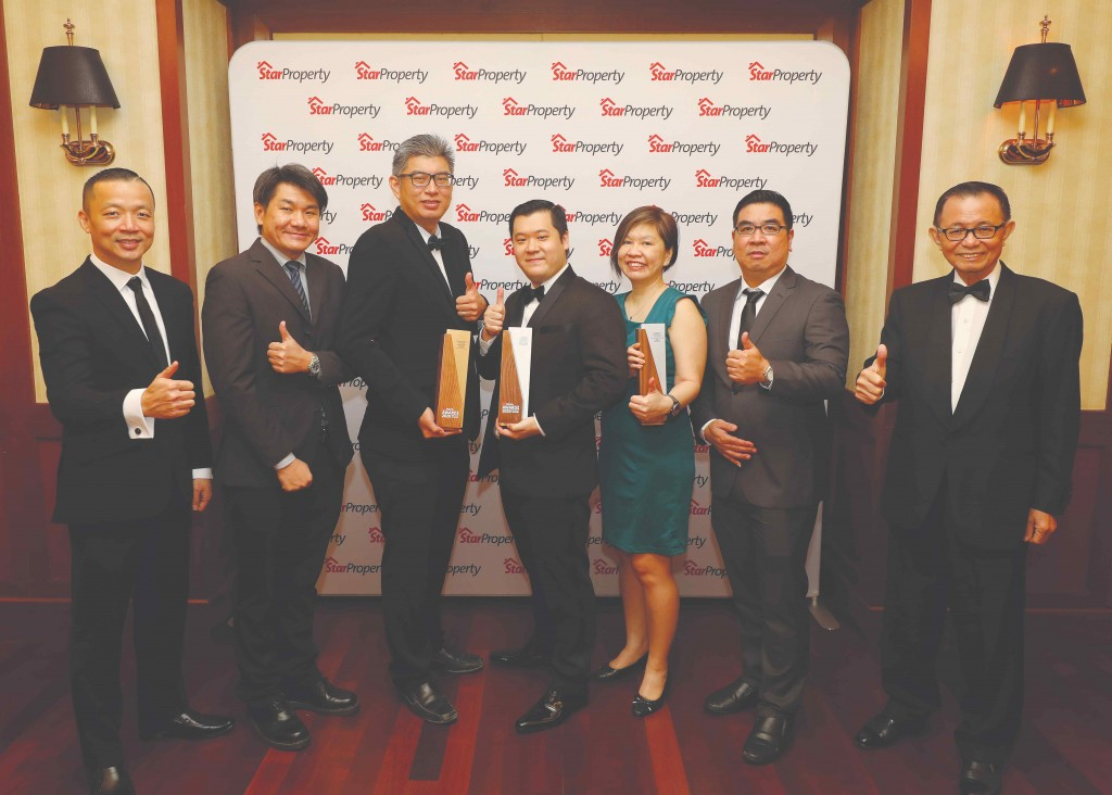 Giving the thumbs up after YNH Property bags three trophies are (from left) Yap, YNH property contract manager How Kean Lok, assistant development manager Yu Chong Cheng, corporate strategy general manager James Ngio, marketing manager Alyz Yeap, development manager Teo Ling Piau and Fu.