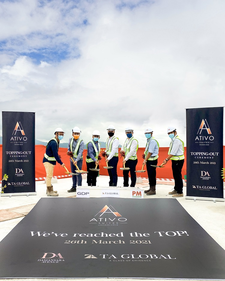 (from left) Yip, Sam, Wan, Lee, Ken, Wie and Soh at the topping-out ceremony.