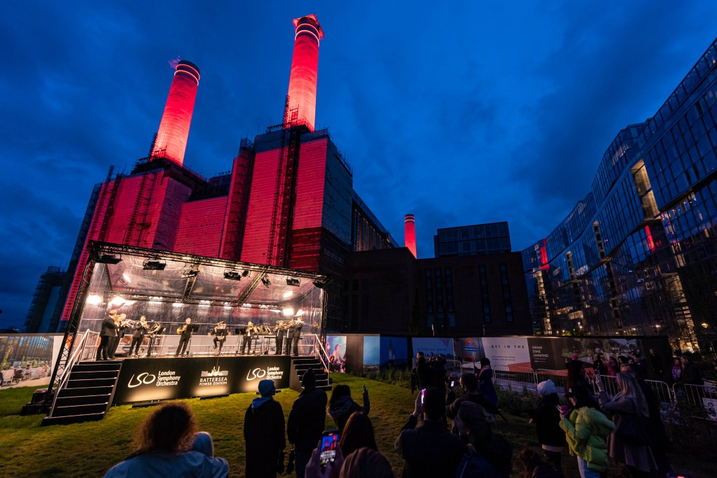 Light projections play on the architecture during a performance by members of the London Symphony Orchestra as Battersea Power Station celebrates handing over the keys to its first residents on May 24, 2021.
