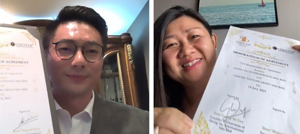 Chew (left) and Leong holding the signed documents.