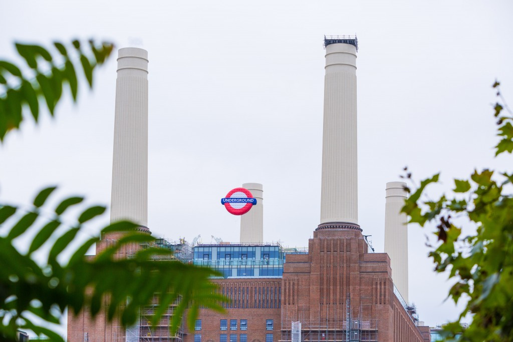 An Underground balloon floats between Battersea Power Station's iconic chimneys to celebrate the opening of   the new rail station. Photo courtesy of Charlie Round-Turner.